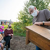 Titus King shows where bats enter in a bat houses to participants during his bat house making seminar Tuesday afternoon at Bushelcraft Farm in Elkhart.