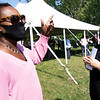 Elkhart City District 6 Councilwoman Tonda Hines, left, speaks with new Habitat for Humanity homeowner Chelsea Hoeflinger before the ground breaking Thursday afternoon in Elkhart.