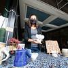 Potter Melanie Helmuth, of Goshen, showcases an elephant mug Saturday along Main Street in Goshen.