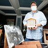 Wood Worker Todd Helmuth, of New Paris, showcases a bee hive Saturday along Main Street in Goshen.