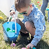 Jaxon Parcell, 4, Millersburg, collects eggs during Grace Community's Church's Easter egg hunt following services Sunday afternoon.