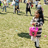 Vicky Garcia, 5, Goshen, heads back to her parents with a bucketful of eggs she collected during an Easter egg hunt at Grace Community Church Sunday afternoon.