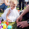 Mirabel Schlabach, 1, Goshen, discovers what's inside the Easter eggs following Grace Community Church's Easter egg hunt Sunday.