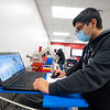 Ever Elias Coraza, 17, of Goshen, programs a robotic arm Friday on a project for his manufacturing class at Goshen High School in Goshen.