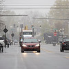 Vehicles travel towards the intersection of South Main Street and East Washington Street Tuesday as a snow front  strikes across Northern Indiana in Goshen.