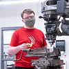 Tyler Daniels, of Goshen, operates a Bridgeport Manual Mill  Friday on a project for his manufacturing class at Goshen High School in Goshen.