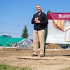 """The Crossing School of Business and Entrepanuarship Career Pathway program instructor Leon """"Duffy"""" Sherman speaks Thursday during the groundbreaking ceremony for Faith Mission of Michiana tiny shelters at 801 Benham Ave. in Elkhart."""
