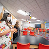 Goshen High School students Alayna McLaughlin, left, and  Ainsley Cain showcase a new classroom following the dedication ceremony for the high school's new wing Monday afternoon.