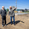 Jim Gleason, of Elkhart, and Tom Graber, Faith Mission of Michiana Chairman, speak with each other Thursday during the ground breaking ceremony for Faith Mission of Michiana tiny shelters at 801 Benham Ave. in Elkhart.