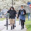 Darl Benton, left, and Acicia Lagro, both of Goshen, walk in the rain along the 200 block of East Purl Street Thursday afternoon in Goshen.