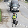 A cyclist uses a trike to travel along the 800 block of South Main Street Friday in Middlebury.