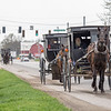 A trio of buggies travel along the 400 block of South Van Buren Street in Shipshewana Friday afternoon.