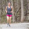 Christine Messick, of Goshen, runs along the wooded trail through the Shoup-Parsons Woods Park near the Goshen Dam on her lunch break Wednesday in Goshen.