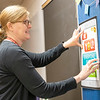 Goshen Junior High School seventh grade school counselor Jill Koop Liechty posts a poster in her office Friday in preparation for the first day of school which is Monday.