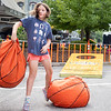 Allie Earnhart, 9, of Albion, Ind., tosses an oversized bean bag at a corn hole board Friday before the First Fridays event in downtown Goshen.