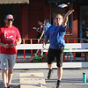 SHEILA SELMAN   THE GOSHEN NEWS<br /> Aaron Kandler of Paw Paw, Michigan, left, watches as Gary Cover of Goshen tosses a bag during a cornhole tournament during First Fridays in downtown Goshen Friday night. Kandler was partnered with Dana Hill of Elkhart. Their team was named Team Cookies and Cream. Cover was partnered with Joey Diaz of Goshen. Their team name was Watch This. The duo of Kandler and Hill won the match.