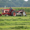 A farmer harvests hay Tuesday in a field  near the intersection of C.R.s 29 and 22 in Goshen. The National Weather Service forecast states the next couple of days will be good for making hay, with a 30% chance of rain today and clear skies Friday.