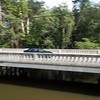 A vehicle passes over the Ind.119 bridge near Shanklin Park Tuesday in Goshen.