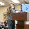 Adam Young showcases photographs of proposed trees to be used to cover the project from view during the Elkhart County Commissioners Meeting Monday at the Elkhart County Administration Building in Goshen.
