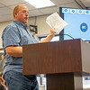 Adam Young  showcases a list of names on a signed petition of people against the proposed solar project during the Elkhart County Commissioners Meeting Monday at the Elkhart County Administration Building in Goshen.