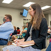 Savion Development Director Sara Mills takes notes during the Elkhart County Commissioners Meeting Monday at the Elkhart County Administration Building in Goshen.