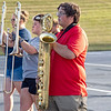 Wawasee High School band member Nik Tennant, rightt, caries a baritone saxophone during practice.