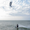 A Kite surfer takes a run away from the shore of Tiscornia Park Wednesday, Aug. 11 in St. Joseph, Michigan.