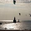 Kite surfers take to the waters of Lake Michigan near the St. Joseph Lighthouse at Tiscornia Park Wednesday, Aug. 11 in St. Joseph, Michigan.