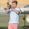 Wawasee High School band member Will Hoy prepares to play his trumpet during practice.