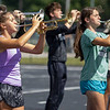 Concord High School band member Ava Plank, left, plays a trumpet during practice Sept.