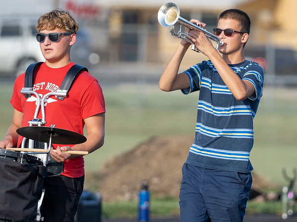Wawasee High School band member Issac Miller, right, plays a trumpet during practice Sept. 2.