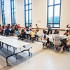Goshen Intermediate School students eat lunch in the cafeteria Monday during the first day of school at Goshen Intermediate School. The numbers on the tables are preassigned and will be the table that the students will sit at everyday during the school year.