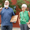 """Electric Brew Owners Myron Bontrager, left, and his wife Dana speak to guests of the Electric Brew after receiving the """"Good of Goshen Award"""" from City of Goshen Mayor Jeremy Stutsman Friday in downtown Goshen. The Electric Brew has been serving the Goshen community for 25 years."""