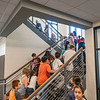 Fifth grade teacher Joel Klase, left top, leads his students up the stairwell Monday during the first day of school at Goshen Intermediate School.