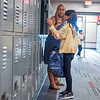 Madalyn Rodriguez, 10, of Goshen, front, receives help from her teacher Michelle Thaxton with her locker Monday during the first day of school at Goshen Intermediate School.