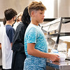Miguel Cortes, 11, receives his lunch the cafeteria Monday during the first day of school at Goshen Intermediate School.