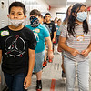 Izick Reyes, left, and Johany Chinchilla Amador lead their classmates through the halls Monday during the first day of school at Goshen Intermediate School.