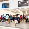 Goshen Intermediate School students receive their lunch in the cafeteria Monday during the first day of school at Goshen Intermediate School. The numbers on the wall are preassigned and will be the line that the students will use everyday during the school year.
