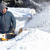 Richard Bender, of Goshen, uses a snowblower to clear his driveway Tuesday morning  at the intersection of Berkey Avenue and Bainbridge Place in Goshen.