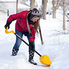 Karoline McLain, of Goshen, clears out her neighbors sidewalk Tuesday morning in the 600 block of North 5th Street in Goshen.