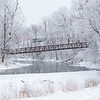 Ice coats over the tree tops Wednesday morning at the Rogers Park foot bridge in Goshen.