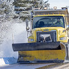 An INDOT snowplow clears the shoulder along IN 119 near Black Squirrel Golf Club Tuesday morning in Goshen.