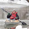 Matthew Lind, of Goshen, kayaks along the Elkhart River Wednesday afternoon between Muller Park and Shanklin Park in Goshen