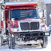 A Goshen Street Department snowplow makes a pass Tuesday morning near the intersection of East Purl Street and South 8th Street in Goshen.