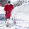 Fred Driver, of Goshen, uses a snowblower to clear a path around his vehicle Tuesday morning near his home in the 300 block of South 6th Street in Goshen.