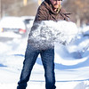 Scott Weisser, of Goshen, assists his neighbor by shoveling out their sidewalk Tuesday morning in the 600 block of South 5th Street in Goshen.