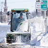 A Goshen City Parks Maintenance Department worker clears the side walk Tuesday afternoon near the intersection of West Lincoln Avenue and South 2nd Street in Goshen.