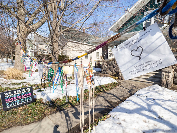 A clothes line filled with masks sewn by Christine Guth located at 218 S. 8th St. basks in the sun Thursday afternoon in Goshen. The masks are available at no charge. Guth has sewn together over 5,700 masks since the start of the COVID-19 pandemic.