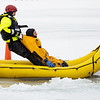 Goshen firefighter  private Kyle Stamm, left, pulls firefighter Lt. Phil Schrock from the frozen pond Monday morning at Shanklin Park during an ice rescue training session in Goshen.