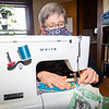 Christine Guth, of Goshen, sews a masks for people who need them Thursday afternoon at her home 406 S. 7th St. in Goshen. Once Guth has several masks created she takes them to hang on a clothes line located at 218 S. 8th St. where the masks are available at no charge. Guth has sewn together over 5,700 masks since the start of the COVID-19 pandemic.